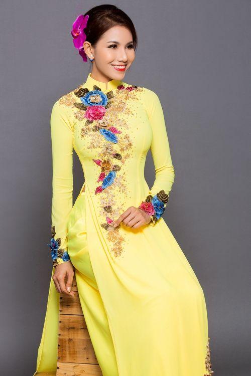 Màu vàng quý phái khi may áo dài cưới đẹp